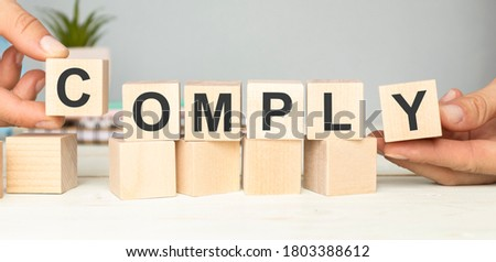 COMPLY word written on building blocks concept Stock photo ©