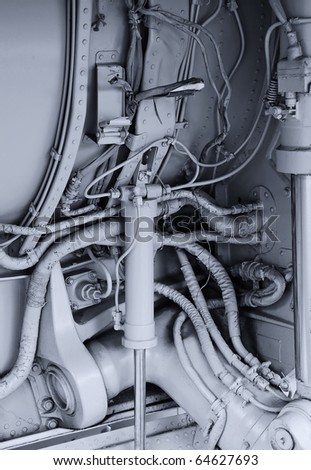 Component parts of hydraulic system. Chassis of a military fighter jet. Industrial texture or background