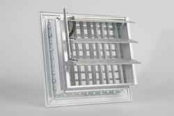 Components for climate technology. White filter for air conditioner. Ventilation grille on a white background. Maintenance of air conditioners. Creating a pleasant microclimate in the house.