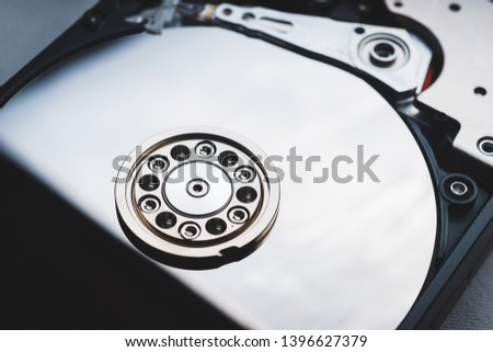 Components for PC. Open hard disk storage. Recovery and storage of information. Magnetic disks inside HDD. Modern digital technology.
