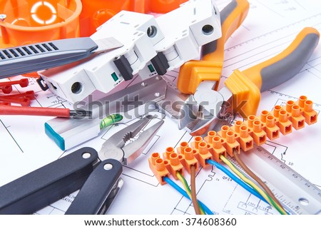 Components for use in electrical installations. Cut pliers, connectors, fuses, knife and wires. Accessories for engineering work, energy concept. #374608360