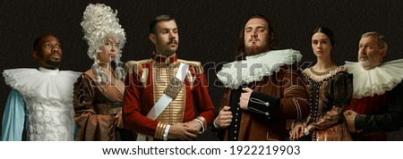 Composed and confident. Medieval people as a royalty persons in vintage clothing on dark background. Concept of comparison of eras, modernity and renaissance, baroque style. Creative collage. Flyer