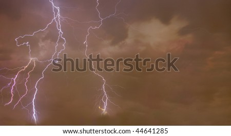 Composite abstract Image of a dramatic background with Lightning bolts in the foreground.
