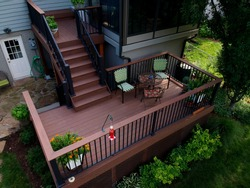 Composite Deck with out door furniture below a sunroom