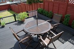 Composite Deck with part restored furniture set and composite planters for box hedging.
