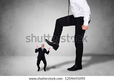 Composite image, bad leadership conflict concept. Big boss trying to stomping step on his small worker