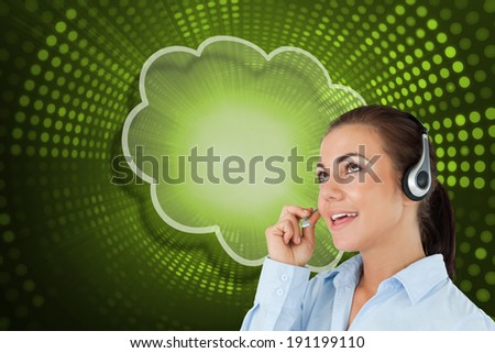 Composite image of cloud and call centre worker against green pixel spiral