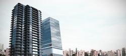 Composite image of3d office buildings against city against blue sky