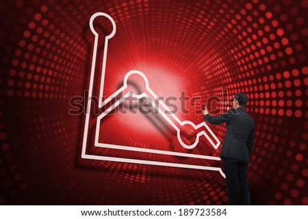 Composite image of graph and businessman pointing against red pixel spiral