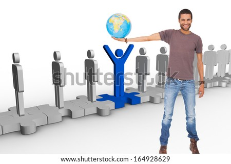 Composite image of handsome man holding out a globe #164928629