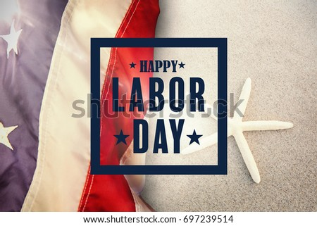 Composite image of happy labor day poster against starfish kept on sand #697239514