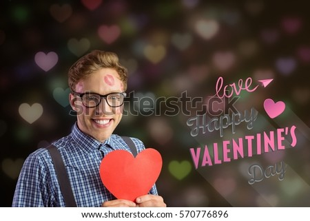 Composite image of love message and nerd man holding red heart against digitally generated background
