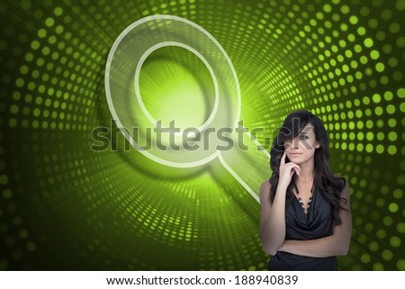 Composite image of magnifying glass and sexy brunette against green pixel spiral