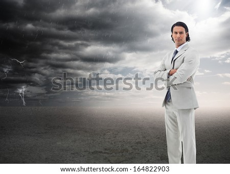 Composite image of portrait of a serious office worker posing with the arms crossed