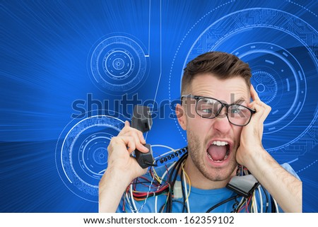 Composite image of portrait of frustrated computer engineer screaming while on call in front of open cpu