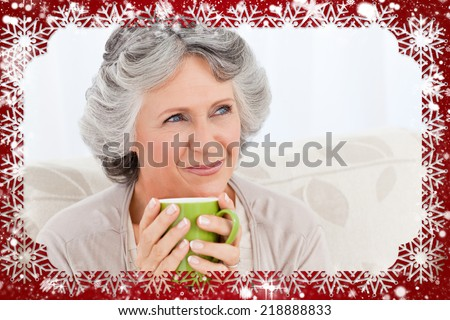 Composite image of senior drinking a cup of tea against snow