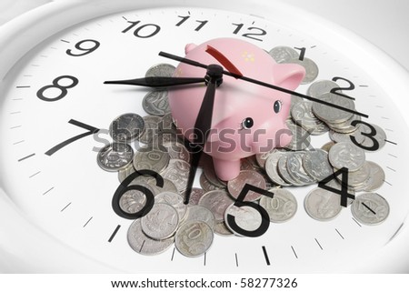 Composite of Piggy bank and Clock