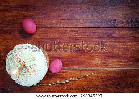 Composition about Orthodox Christian Easter with red eggs and a cake