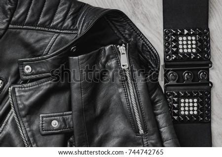 Composition, Black women's leather jacket and black leather belt. #744742765
