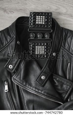 Composition, Black women's leather jacket and black leather belt. #744742780