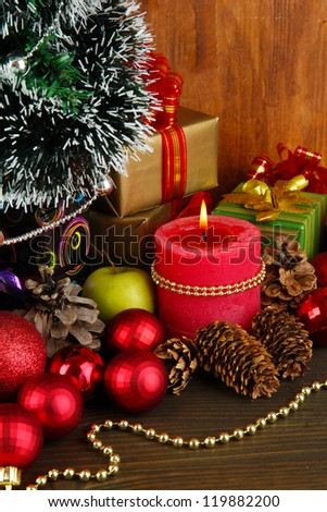Composition from Christmas decorations close-up on wooden table on wooden background