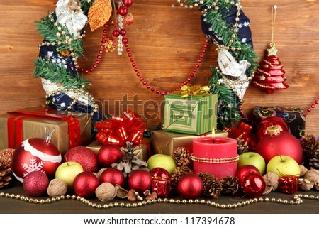 Composition from Christmas decorations on wooden table on wooden background