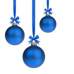 composition from three blue christmas balls hanging on ribbon, white background