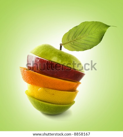 Composition made from pieces of apple,lemon  and orange  on isolated green background