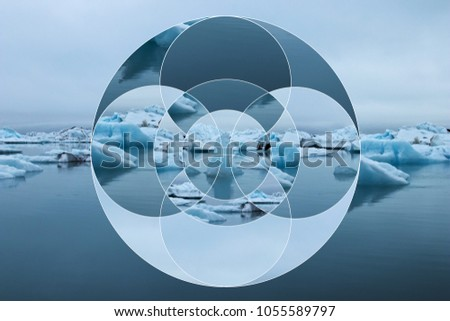 Composition of a iced landscape with iceberg and sea decomposed into symmetrical geometric figures as in a prism. Abstract concept in cold colors. Landscape in geometrical composition, kaleidoscope