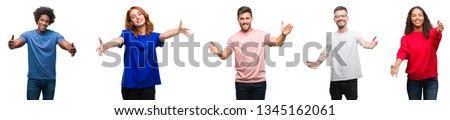 Composition of african american, hispanic and caucasian group of people over isolated white background looking at the camera smiling with open arms for hug. Cheerful expression embracing happiness.