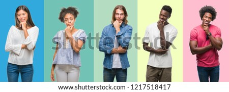 Composition of african american, hispanic and chinese group of people over vintage color background looking confident at the camera with smile with crossed arms and hand raised on chin. Thinking