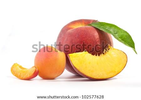 Composition of apricot and peach, isolated on white background