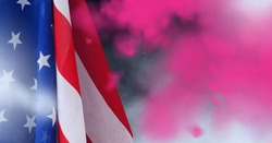 Composition of billowing american stars and stripes flag over colourful pink flare smoke. patriotism, independence and celebration concept digitally generated image.