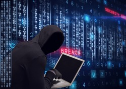 Composition of binary coding and cyber crime warning text over hacker in hood using laptop. online security cyber attack concept digitally generated image.