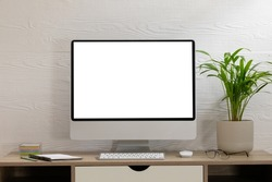 Composition of desktop computer with copy space on white background. modern office communication and technology concept.