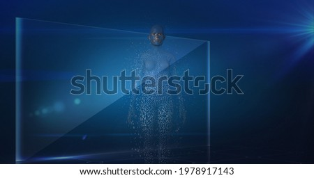 Composition of exploding human body formed with grey particles and screen on blue background. global online identity and security concept digitally generated image.