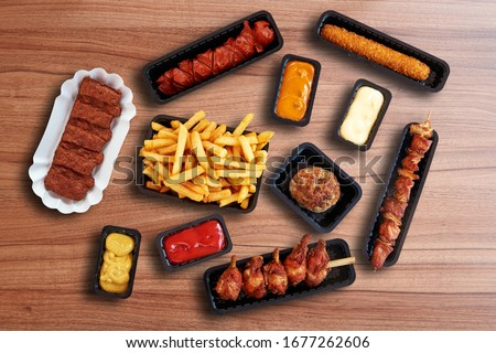 Composition of Fast food Snacks, sausage and french fries Foto stock ©