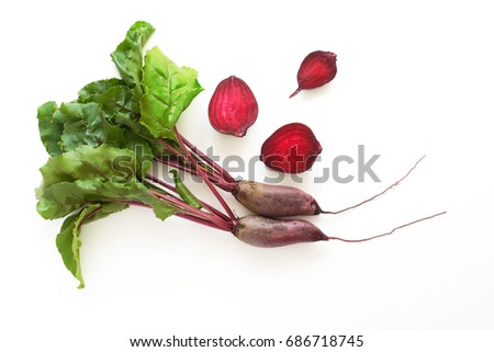Composition of fresh beets with tops and beets in a cut isolated on a white background. Healthy food. Top view, flat lay.