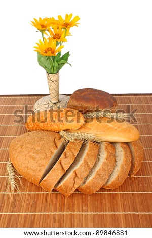 Composition of fresh bread and bakery with ear of wheat, burlap and flowers foodstuffs