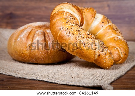 Composition of fresh bread on wood