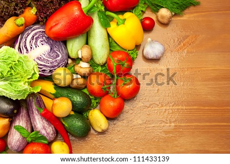Composition of fresh Organic Vegetables /  with Water Drops / on the Wooden Desk