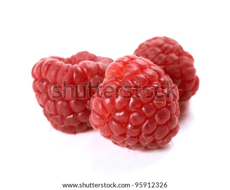Composition of fresh ripe raspberries isolated on white background. Shallow depth of field.