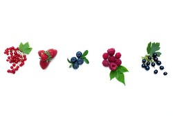 Composition of fresh strawberries, red currants, blueberries, raspberries, black currants with leaves on white. Top view