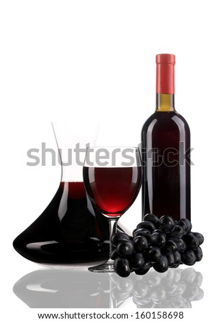 Composition of grapes and red wine. Isolated on a white background.