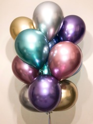 Composition of helium balloons in chrome blue, silver, gold, green, pink and purple colors