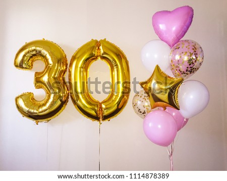 Composition of helium balloons white, pink, transparent with confetti, as well as a gold star and a large figure of thirty golden colors. Gift for 30 years for a girl