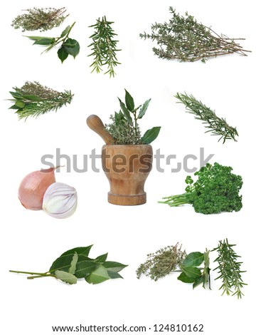 composition of herbs and a wooden pestle in the center