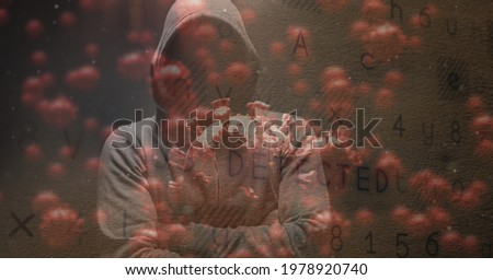 Composition of hooded hacker with covid cells and security warning message. global coronavirus pandemic and cyber security concept digitally generated image.