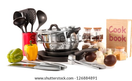 composition of kitchen tools,spices and vegetables isolated on white