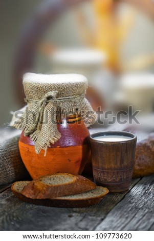 Composition of milk on the bread, the old background